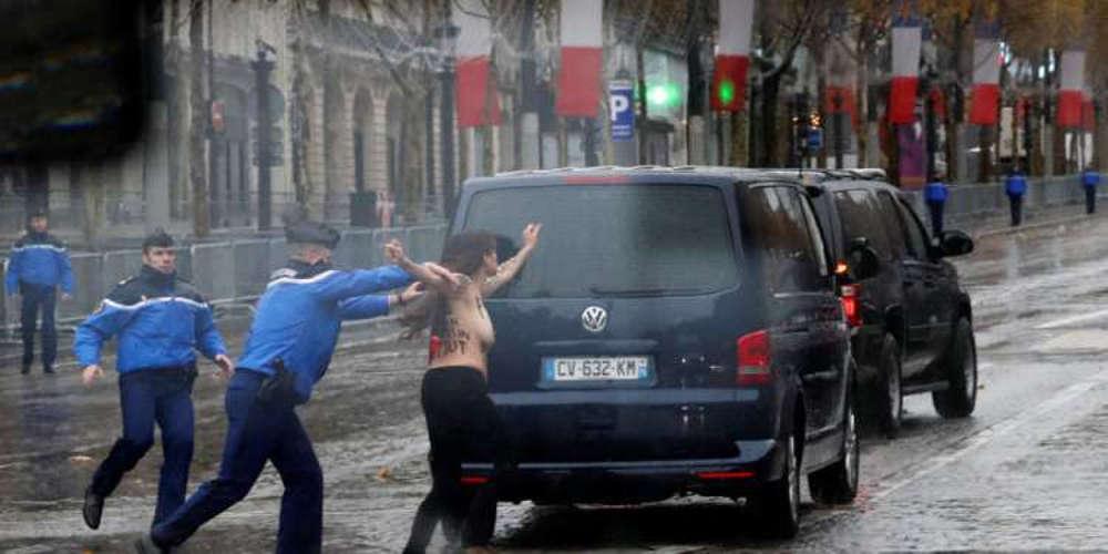Γυμνόστηθη «επίθεση» στην αυτοκινητοπομπή του Τραμπ στο Παρίσι από τις Femen [εικόνες & βίντεο]
